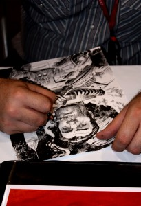 Tony Moore sketches something other than zombies at his table. Photo By: Alexa Tomaszewski
