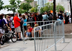 Fans line up at Fan Expo 2011, some of them on weary feet already. Photo By: Alexa Tomaszewski