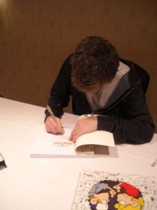 Bill Amend signs for a fan.