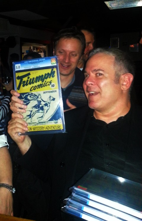 Stephen Lipson holds up a slabbed Triumph 2 from that brief case. Other books in it were the Nelvana one shot (6.5), Dime 1 (9.0), Super Comics nn (4.5).