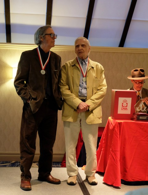 Gerald Lazare and Jack Tremblay on stage receiving their awards.
