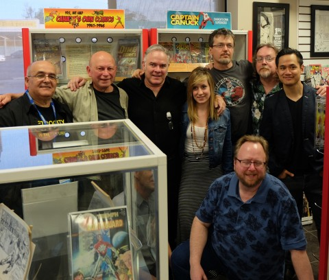 Group shot of some of the attendees, Richard Comely is hidden kneeling behind the small display case.