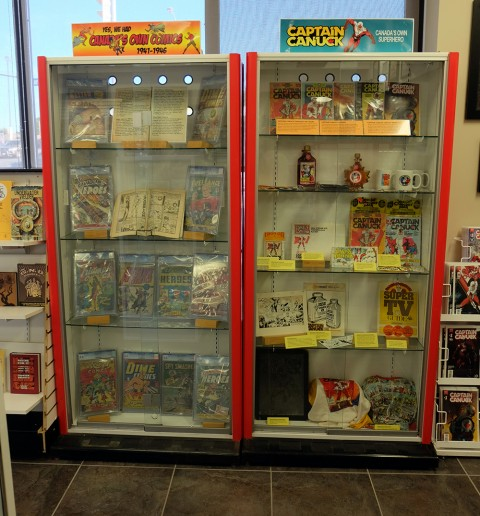 The WECA display case and the Captain Canuck display case together