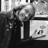 """Clive Smith, chief cartoonist and partner/ Nelvana Prods., checking the storyboard of """"The Devil &Dan'l Mouse""""."""